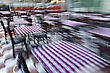 Intentional In Camera Motion Blur Of A Street Outdoor Cafe With Empty Tables stock photo