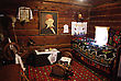 Interion Of Traditional Medieval Country Cottage Room In Serbia With Bed, Hand Made Carpets, Etc.