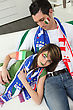 Italian Couple On Couch Waiting For Soccer Match stock photography