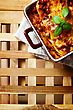 Italy Italian Food. Hot Tasty Lasagna Plate Served With Fresh Basil Leaf. Wooden Table Background. Top View, Space For Your Text stock image