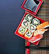Rice Japanese Seafood Sushi And Chopstick On A Black Background For Text stock photo