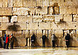 Jewish JERUSALEM - DECEMBER 15: The Western Wall In The Night With A Praying Pilgrims On December 15, 2013 In Jerusalem. It's Located In The Old City Of Jerusalem At The Foot Of The Western Side Of The Templ stock photo