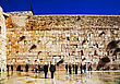 Judaism JERUSALEM - DECEMBER 15: The Western Wall In The Night With Praying Pilgrims On December 15, 2013 In Jerusalem. It's Located In The Old City Of Jerusalem At The Foot Of The Western Side Of The Temple  stock photo