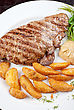 Juicy Beef Steak Stuffed With Beef Tongue And Cheese Served With Potatoes, Greenery And Sauce stock photography