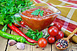 Ketchup In A Glass Gravy Boat, Tomatoes, Parsley, Hot Pepper, Garlic, Napkin On A Wooden Boards Background stock photography