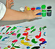 Kid Paints With Her Fingers With Different Color Paint stock image