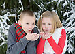 Kids Blowing Snow stock photo