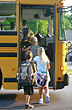 Kids Getting on School Bus stock photo