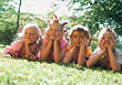 Kids Laying in Grass stock image