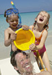 Kids Pouring Bucket of Water on Dad