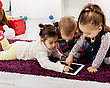 Kids with tablet in the room stock image