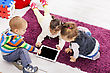 Kids with tablet in the room stock photo