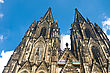 Koelner Dom Of Saint Peter And Mary (Cologne Cathedral) Over Blue Sky. UNESCO World Heritage Site.
