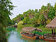 Landscape And Walking Canoe On River In French Polynesia stock photography