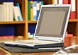 Laptop Computer On Desk In Library stock image
