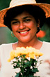 Latino Woman with Hat and Flowers stock photo
