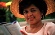 Latino Woman with Hat Reading