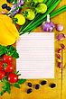 Lined Sheet Of Paper Small Red And Yellow Tomatoes, Yellow Bell Pepper, Green Onions, Parsley, Whole And Two Cloves Garlic, Black Beans And Kidney Beans On A Wooden Board stock photo
