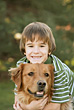 Little Boy and Golden Retriever stock photo