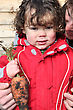 Little Boy Holding Organic Carrot stock photo