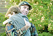 Children Little Boy Hugging Military Dad stock photo