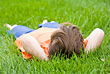 Close Little Boy Laying in Grass stock image