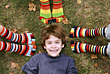 Little Boy Surrounded by Colorful Feet stock photo