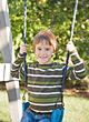 Little Boy Swinging stock image