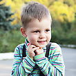 Small Little Cute Smiling White Boy Outdoors Portrait stock photo