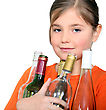 Little Girl Carrying Glass Bottles stock photo