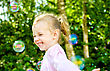 Little Girl Having Fun With Soap Bubbles In The Park stock photography