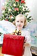 Little Girl Holding Christmas Gift stock photo