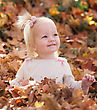 Little Girl in the Autumn Leaves stock image