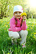 Little Girl Is Smelling Dandelion In The Field stock photo