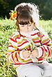 Smiling Little Girl With Leaves Outdoors On Autumn Sunny Day stock photo