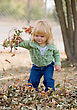 Little Girl Playing in the Leaves stock photography