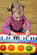 Little Girl Playing The Piano stock photography