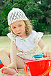 Little Girl Playing With Toys On The Beach stock photo