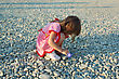 Miracle Little Girl On A Stony Beach At The Sea stock photo