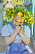 Little Girl With A Wreath Of Yellow Flowers On Her Head stock photography