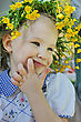 Little Girl With A Wreath Of Yellow Flowers On Her Head stock photo