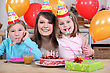 Little Girls With Mom At Birthday Party stock image