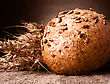 Loaf Of Bread And Wheat Ears Still Life On Rustic Background stock photography