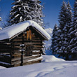 Winter Photos Log Cabin in Winter stock photo