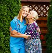 Lovely Patient Being Pleased With Homecare Services, Kissing Her Doctor stock photo