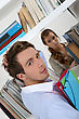 Male And Female Students In Library stock photo