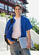 Male College Student Carrying Laptop stock photography