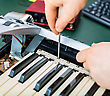 Male Hand Fixing Midi Keyboard Controller stock photo
