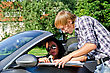 Male Tourist Asking Female Driver About Direction stock photo