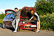 Man And Woman Near The Broken Car. stock photo